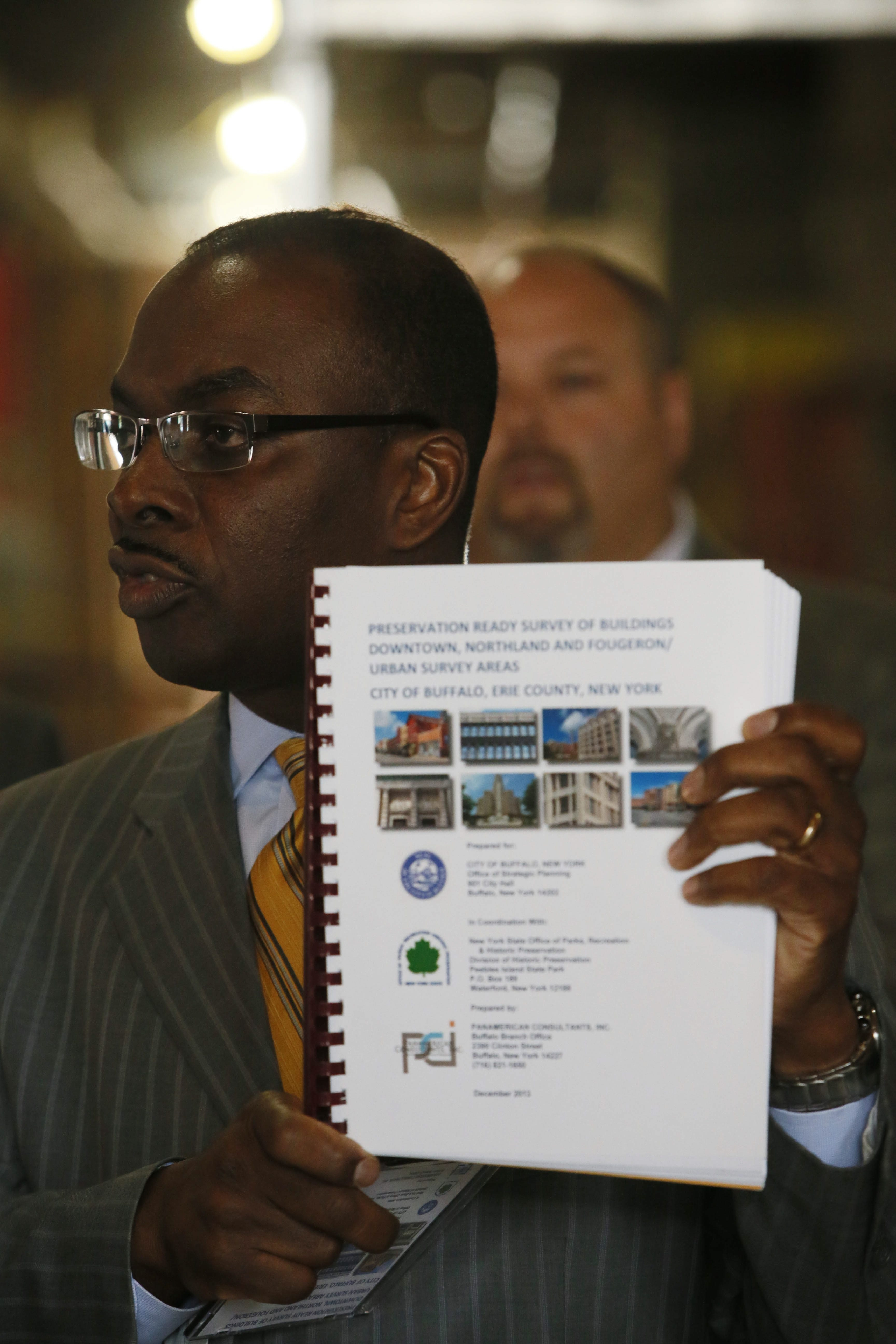 Buffalo Mayor Byron W. Brown unveils a comprehensive list of properties that could be eligible for historic redevelopment tax credits in the downtown corridor during an event in a planing mill that is under redevelopment into 22 apartments and commercial office space by TM Montante.