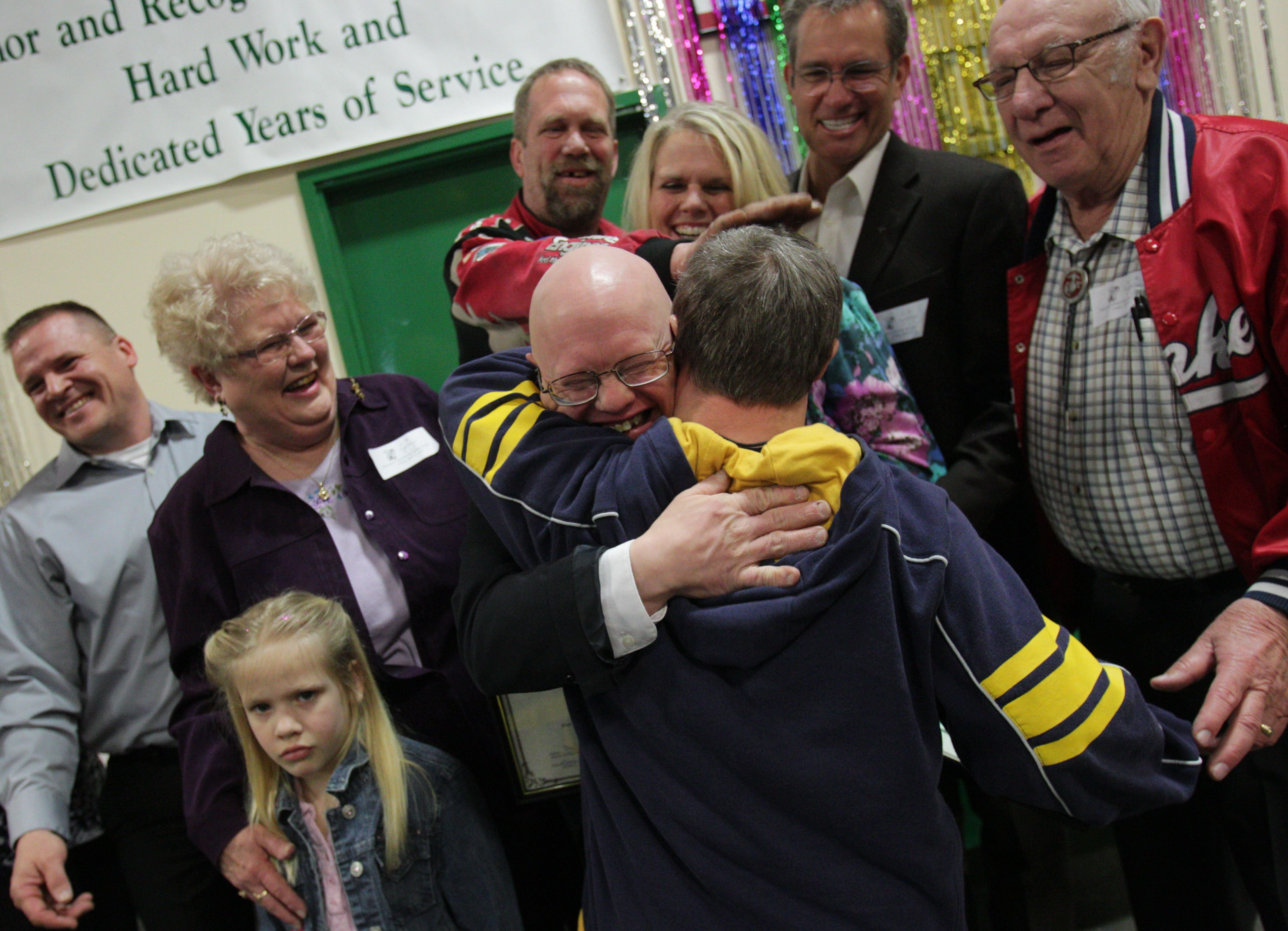 Bob Edwards, wearing glasses, was honored for 25 years of service and received a hug from his best friend, Jon Sereno. See a photo gallery of the event at Buffalonews.com