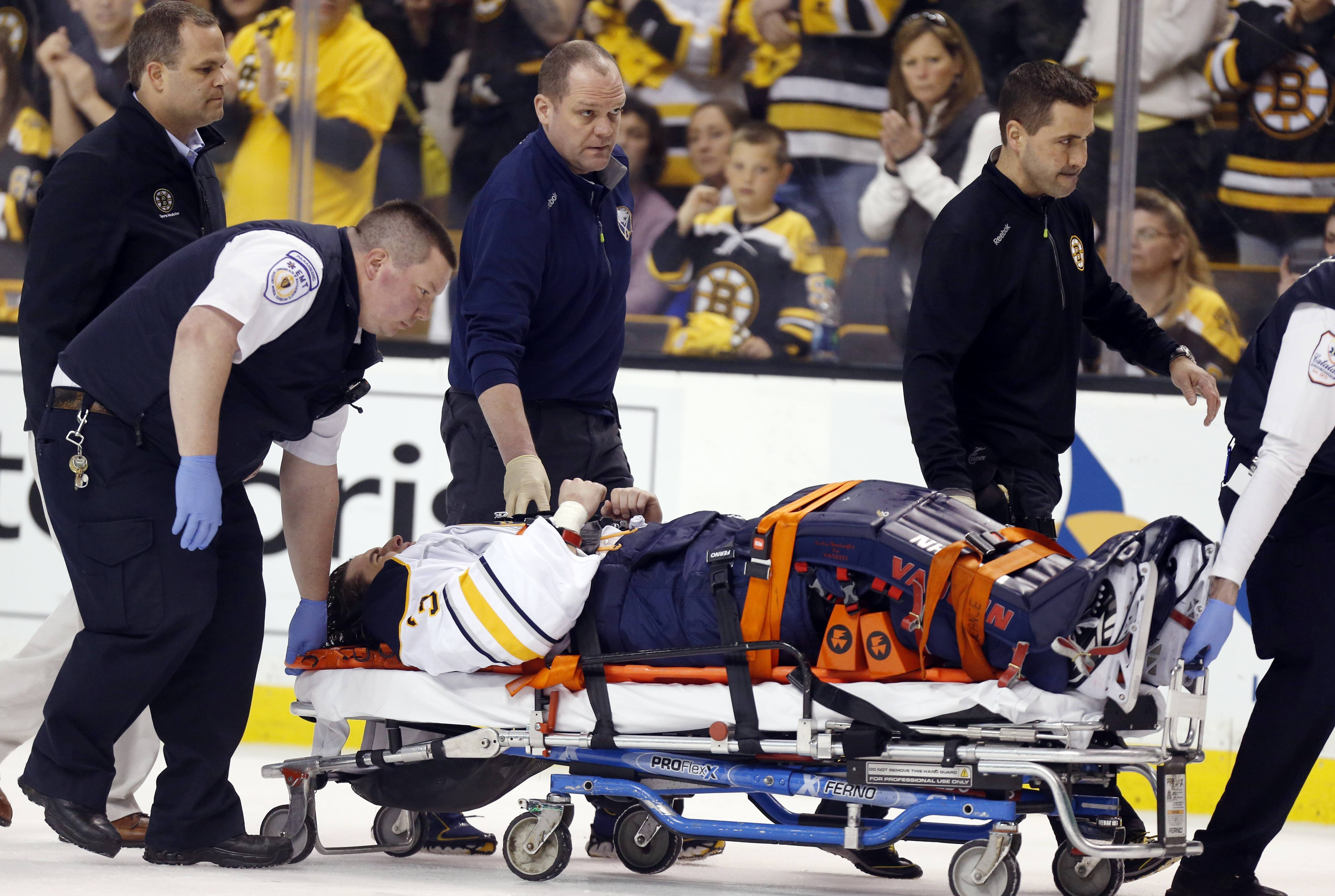 Buffalo Sabres' Matt Hackett (31) is carted off the ice on a stretcher after getting injured in the third period of an NHL hockey game against the Boston Bruins Saturday.