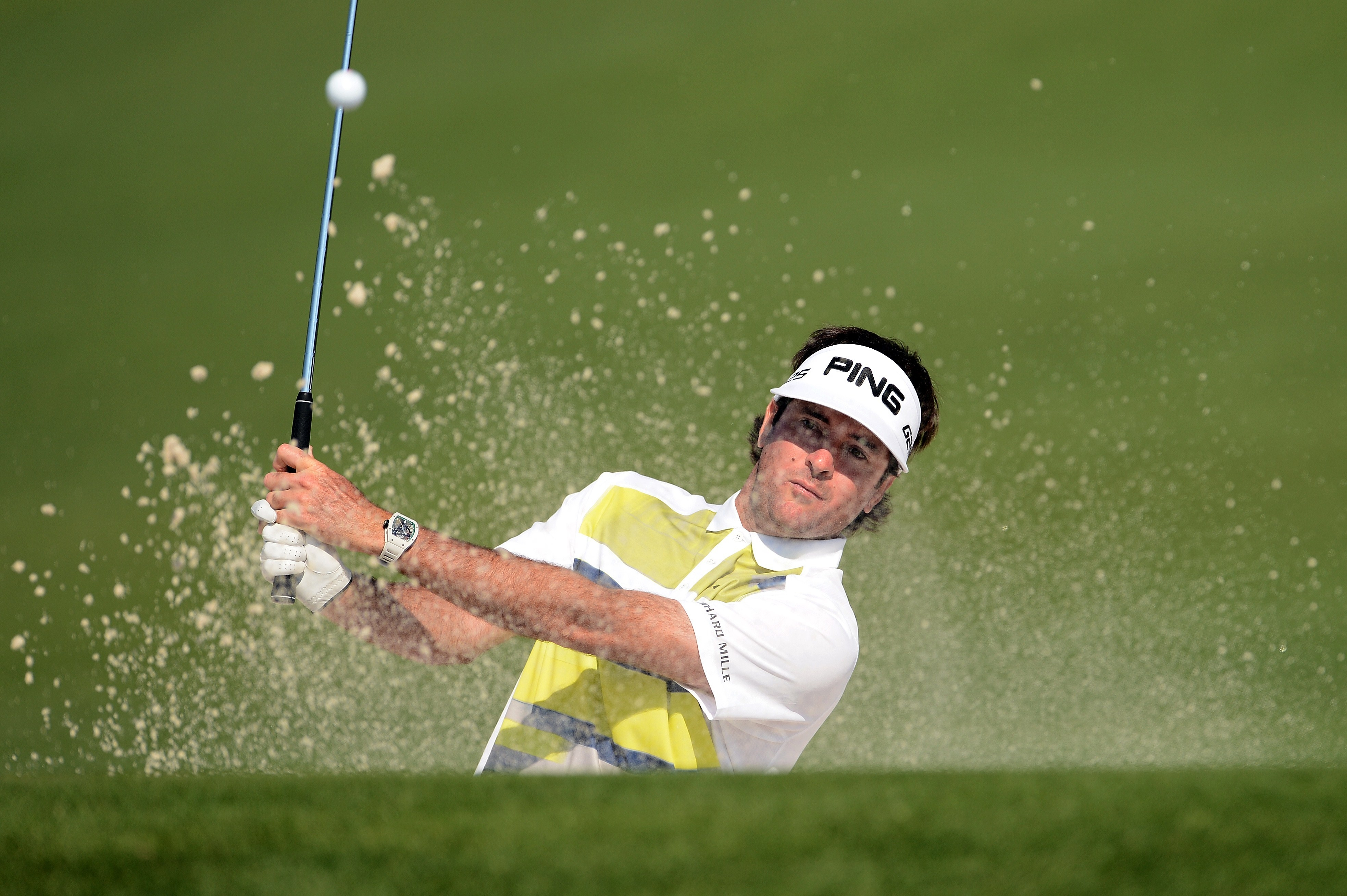 Leader Bubba Watson plays a shot out of a second-hole bunker during the second round of the Masters Friday in Augusta, Ga.