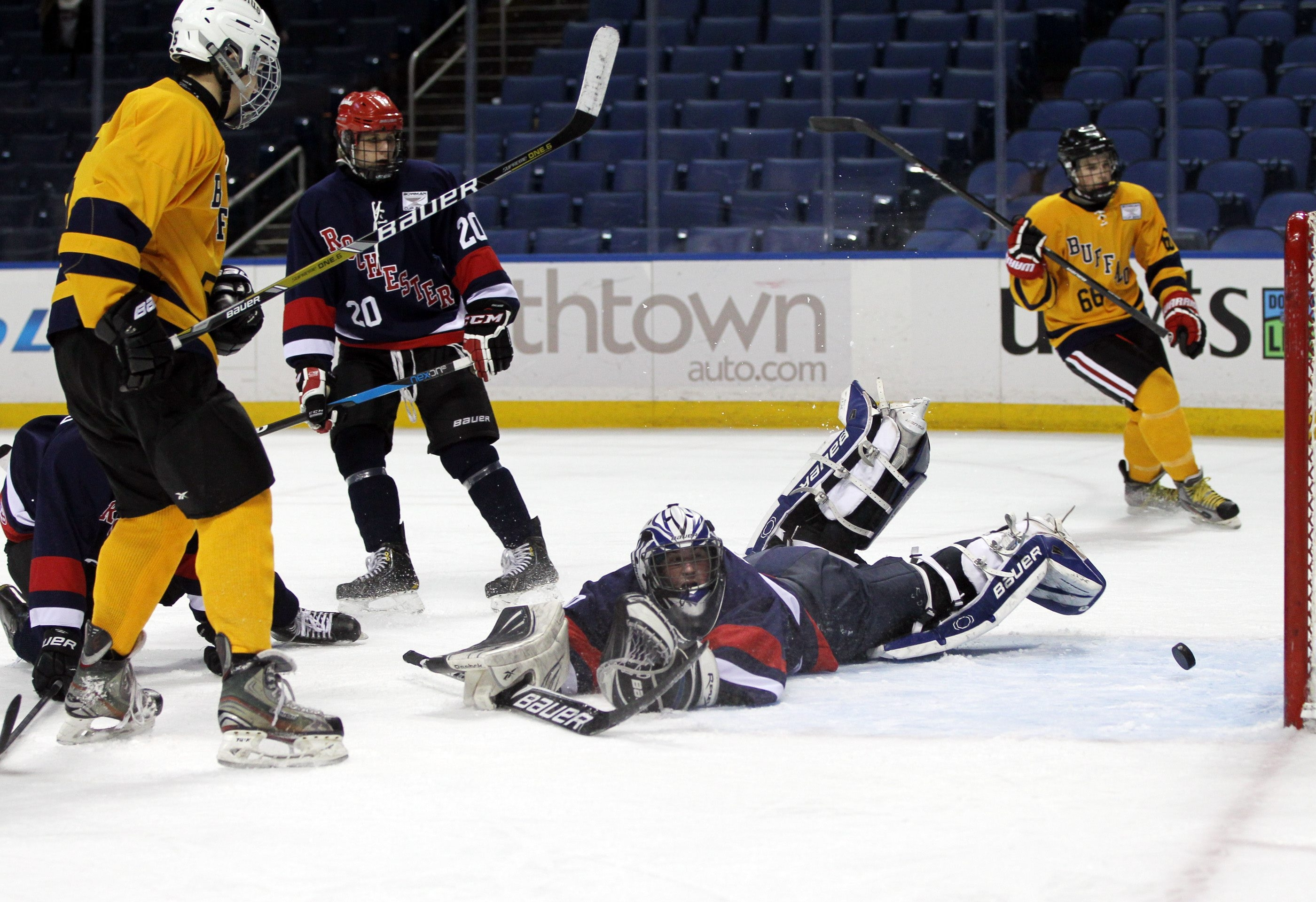 Buffalo's Steve Skinner scores against Rochester goalie Connor Greene during the Senior All-Star Game at the Scotty Bowman Showcase. Buffalo swept the three all-star games in the showcase at First Niagara Center – taking the seniors' game, 3-2, the Juniors' All-Star Game, 4-3,  in a shootout, and the Prep School/Junior League contest, 4-3, in overtime.