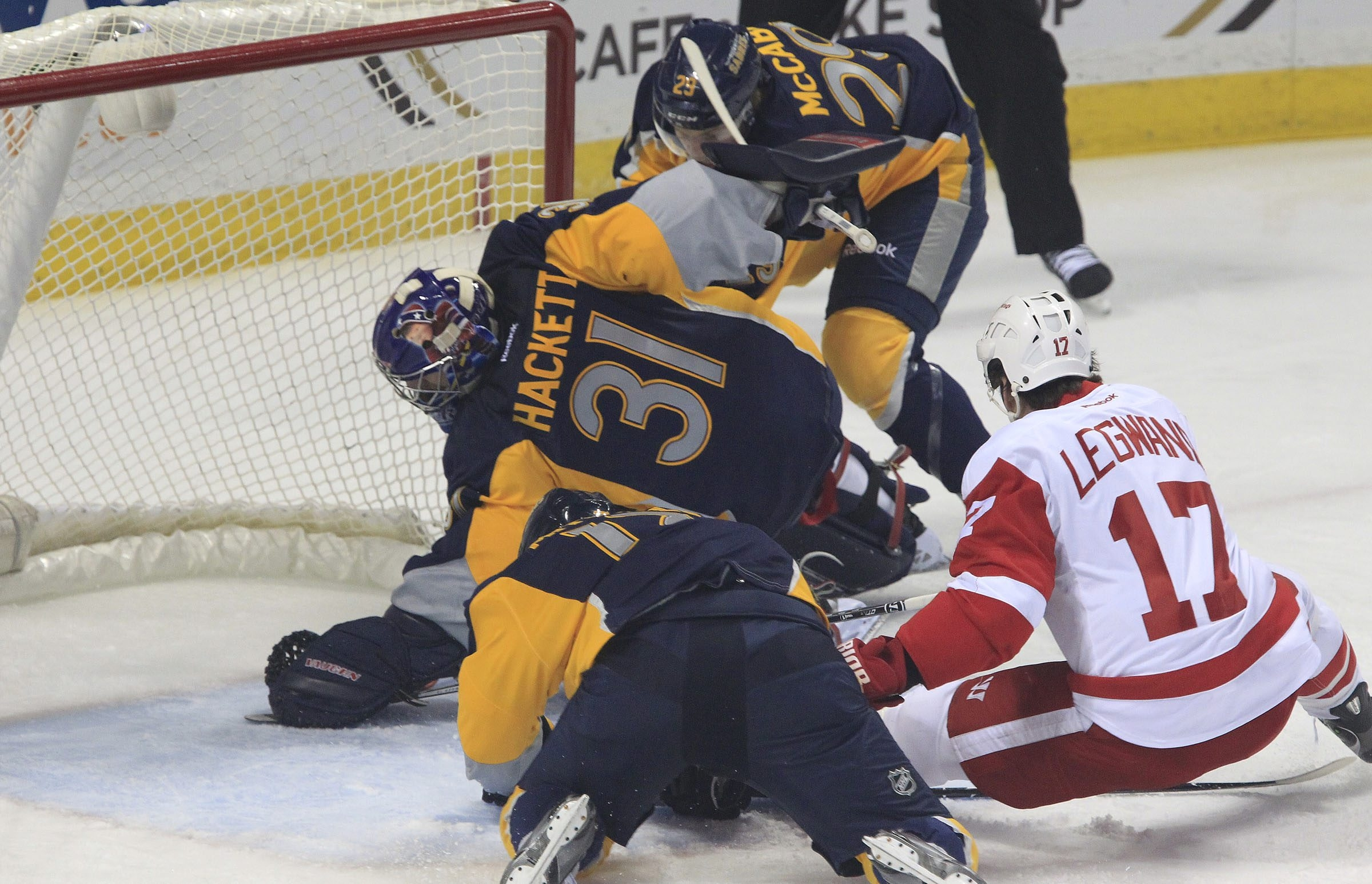 Sabres goaltender Matt Hackett reaches into the crease to stop a Detroit Red Wing shot in the first period at First Niagara Center.