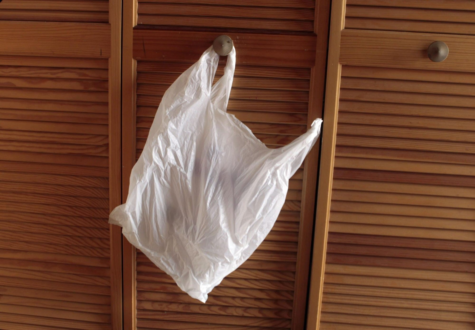 It's not a good idea to have your wastebasket hanging on a door. It makes it hard to keep your hands clean when throwing things away. (Rick Wood/Milwaukee Journal Sentinel/MCT)