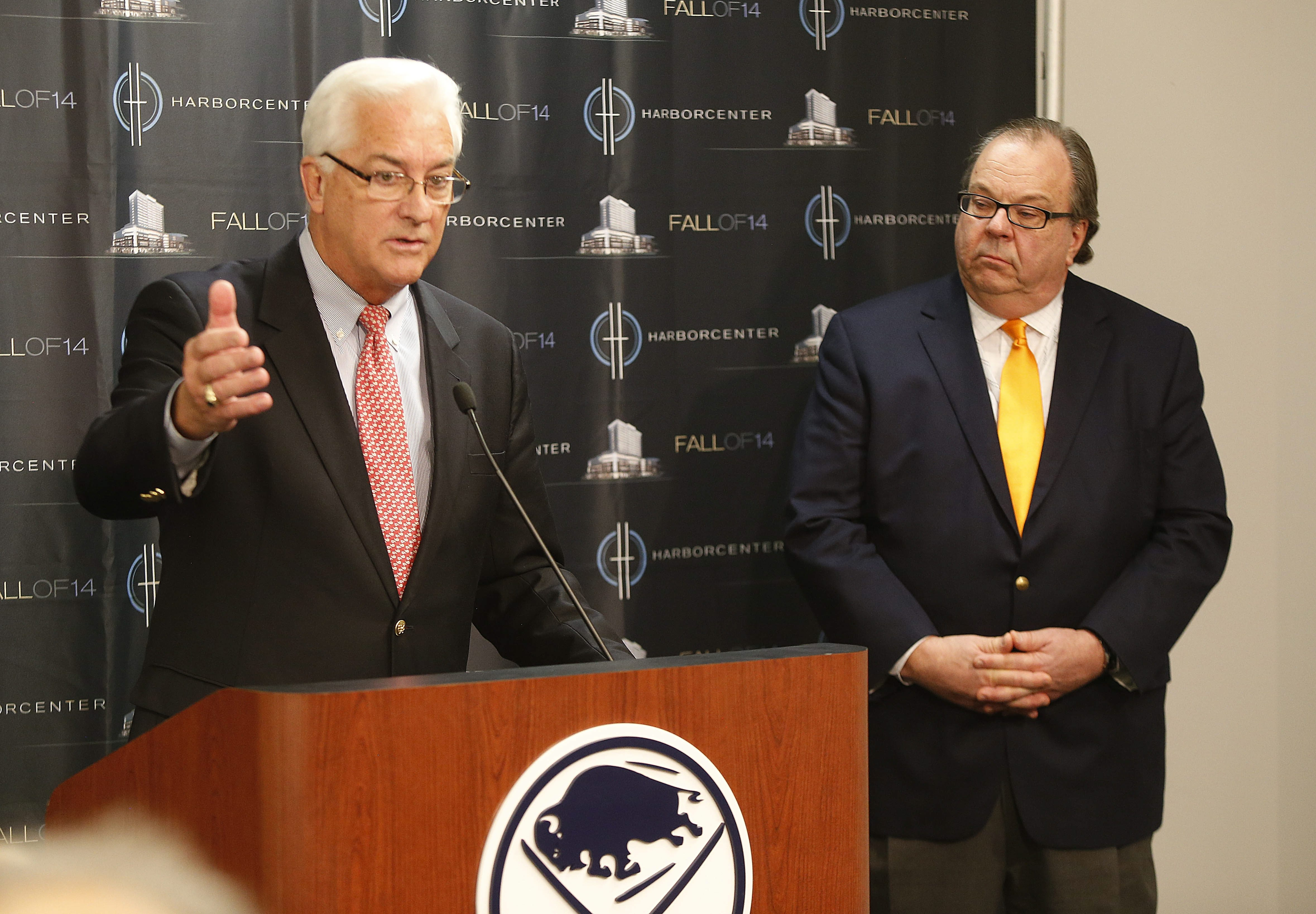 ECC President Jack F. Quinn Jr. makes a point at news conference as he and John R. Koelmel, chief of HarborCenter, explain plans.