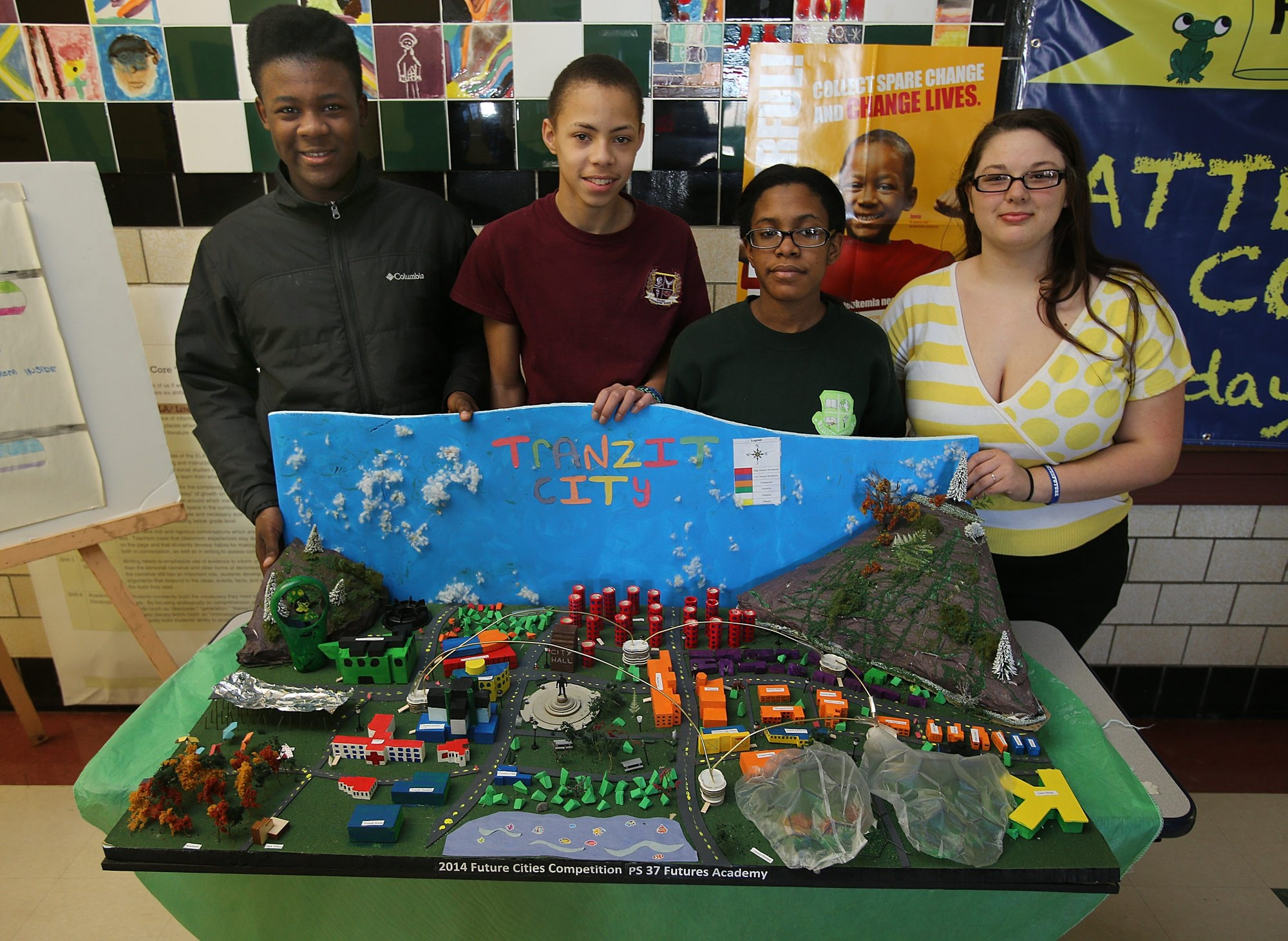Futures Academy team – from left, Zwanie Wright, 14; Johnathen Nelson, 14; Karion Carter, 13; and Monsonna Schaef, 15 – displays entry that earned regional honors among 15 WNY rivals that vied in the 2014 National Engineers Week Future City Competition.
