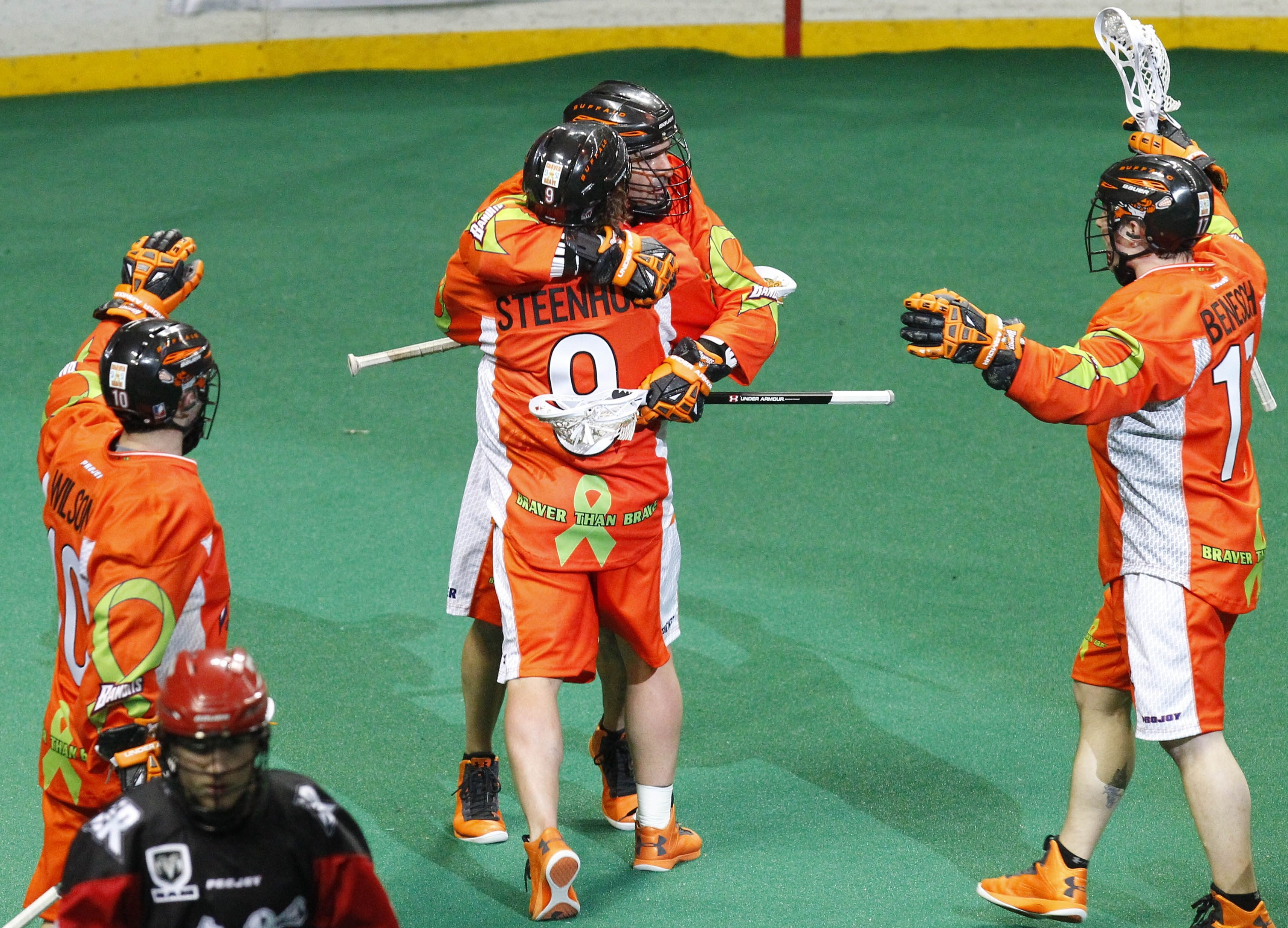 The Bandits' John Tavares gets a hug from Mark Steenhuis during the celebration after Tavares scored his 800th career goal, most in NLL history.
