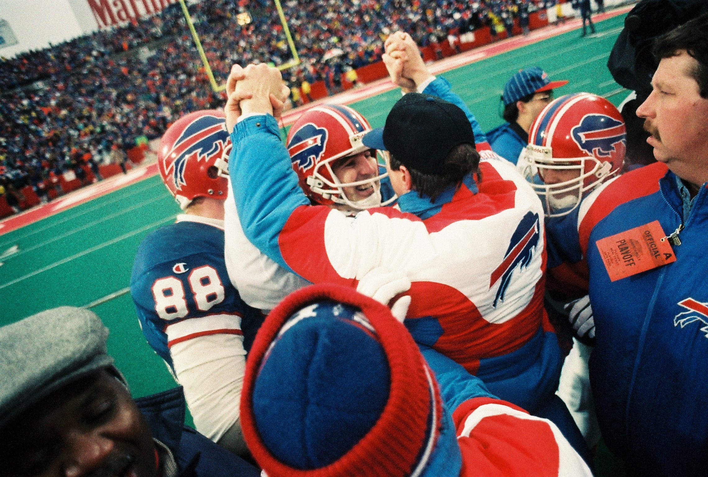 Jim Kelly, who was out with an injury that day, high fives Frank Reich after the comeback win over Houston.