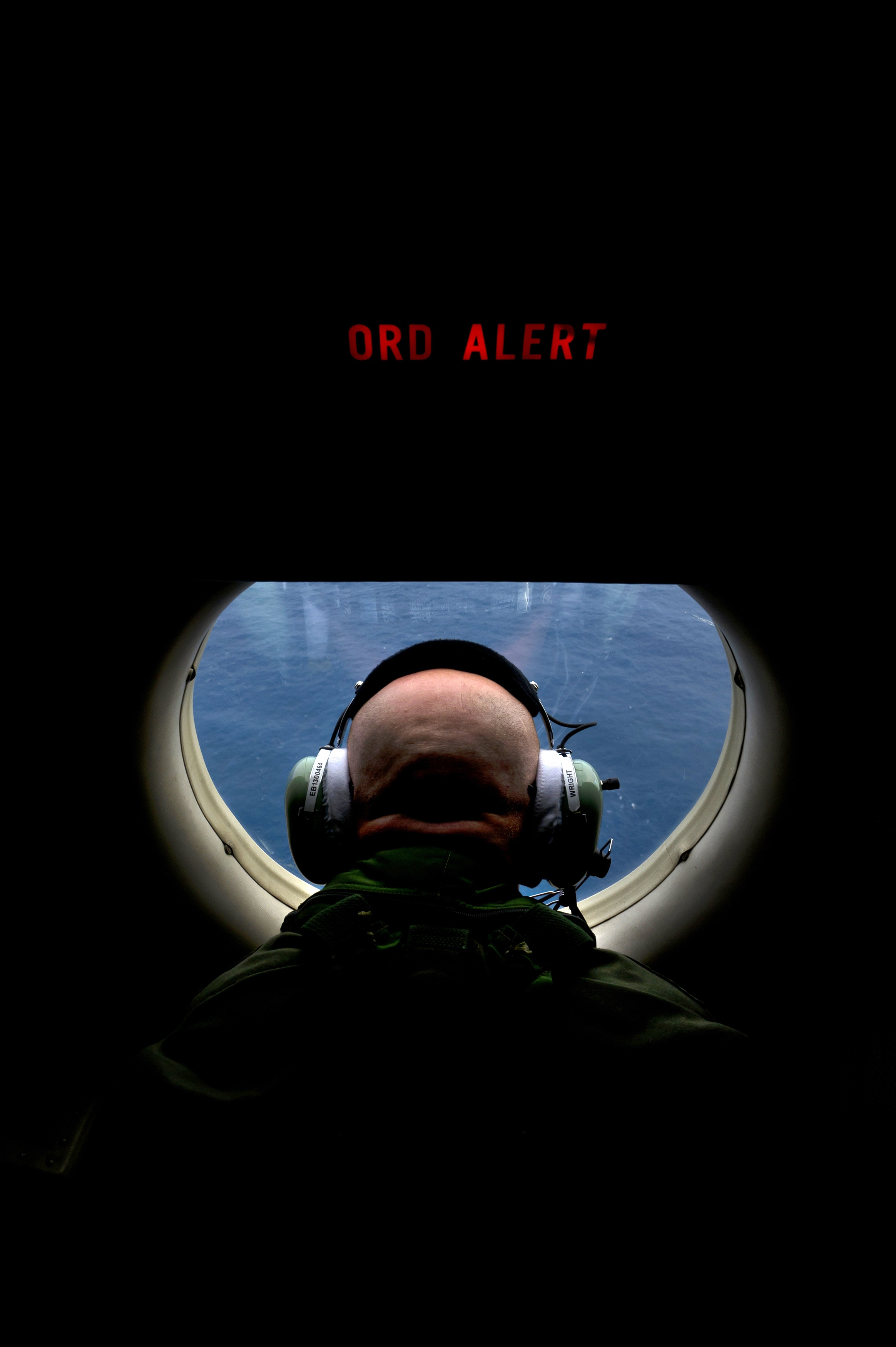 Michael Wright looks from an observation window aboard a Royal Australian Air Force AP-3C Orion aircraft for signs of the missing Malaysian Airlines Flight 370 over the southern Indian Ocean, April 1.