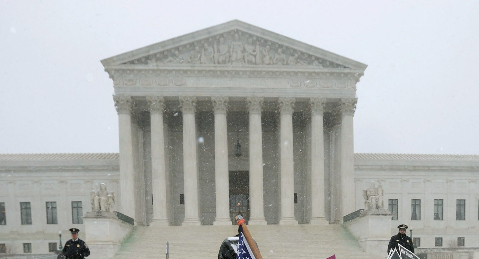 WASHINGTON, DC – MARCH 25:  Demonstrators who disagree stand back-to-back during a rally outside of the U.S. Supreme Court during oral arguments in Sebelius v. Hobby Lobby March 25, 2014 in Washington, DC. The court heard from lawyers on both sides of Sebelius v. Hobby Lobby, a case that may determine whether the Religious Freedom Restoration Act of 1993 allows a for-profit corporation to deny its employees the health coverage of contraceptives to which the employees are otherwise entitled by federal law, based on the religious objections of the corporation's owners.  (Photo by Chip Somodevilla/Getty Images)