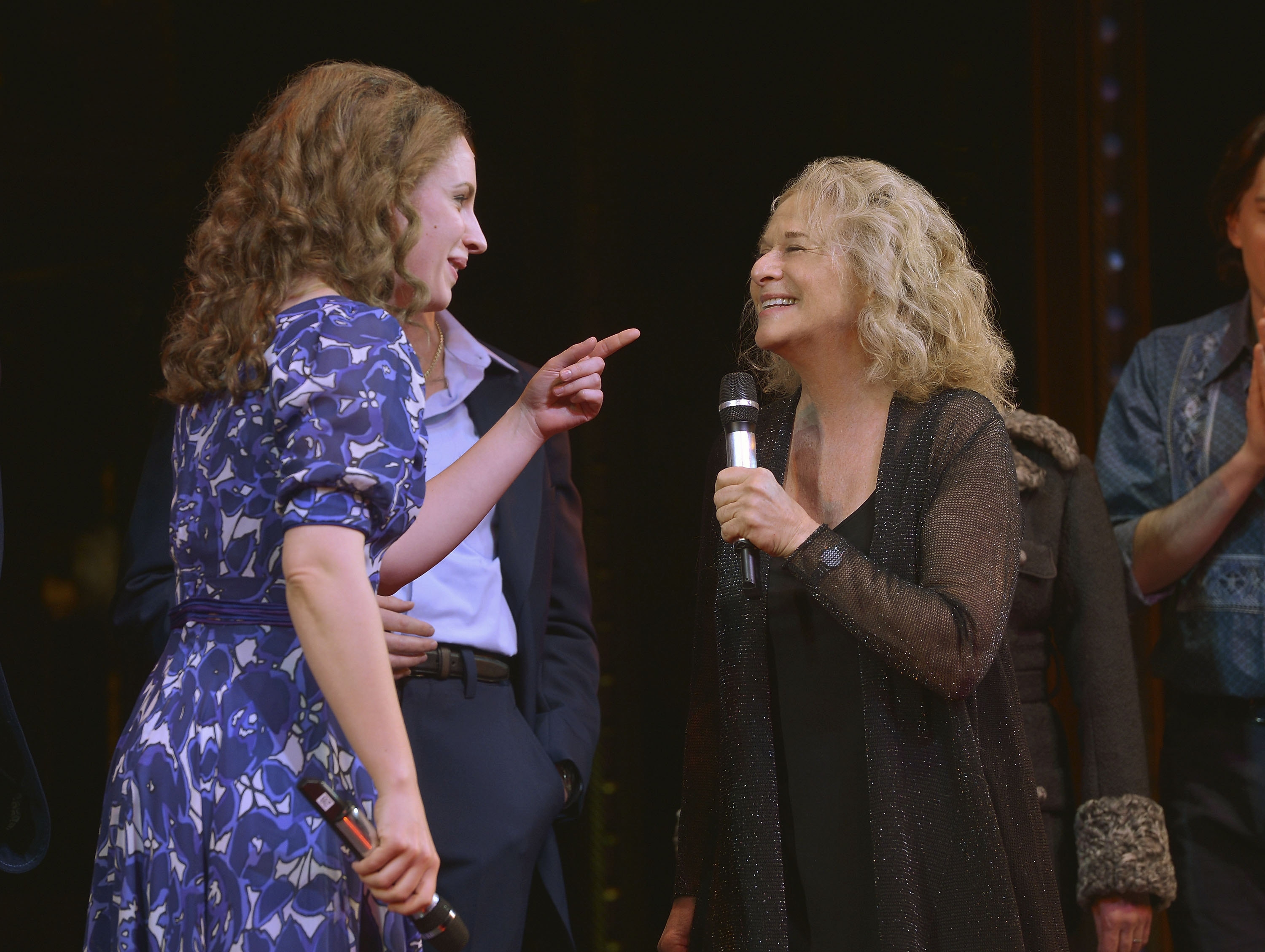 "Superstar Carole King, right, surprises Jessie Mueller and the rest the cast of ""Beautiful"" on Broadway in the Stephen Sondheim Theater on Thursday in New York City."