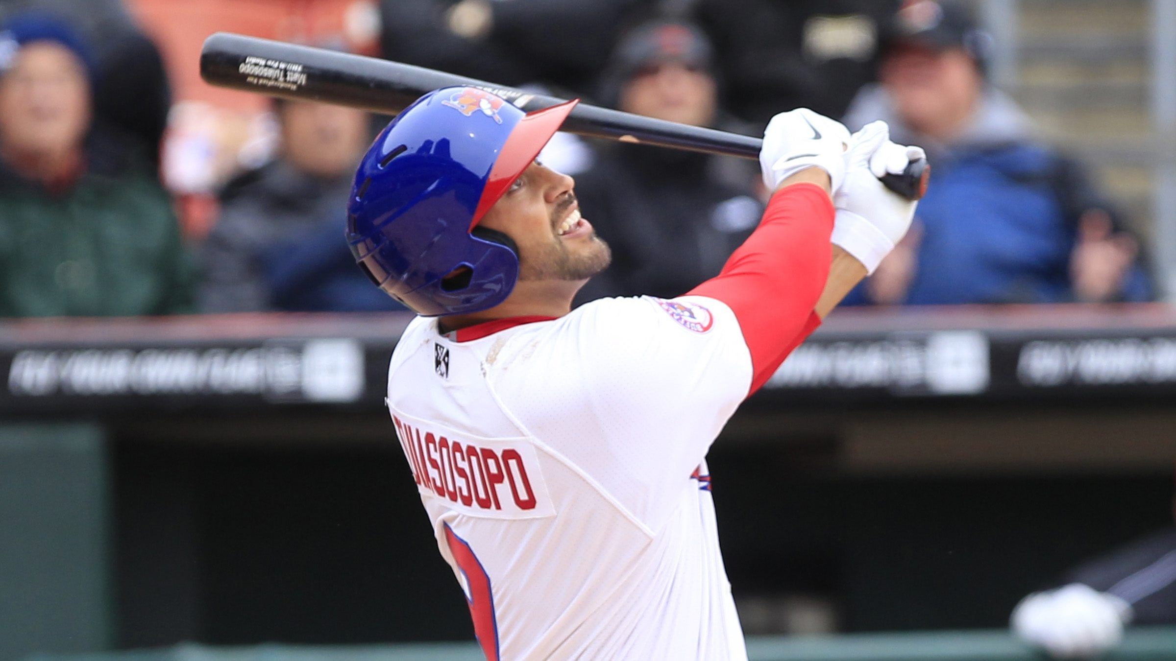 Buffalo Bisons Matt Tuiasosopo gets a first inning base hit against the Rochester Red Wings during opening day at Coca-Cola Field.