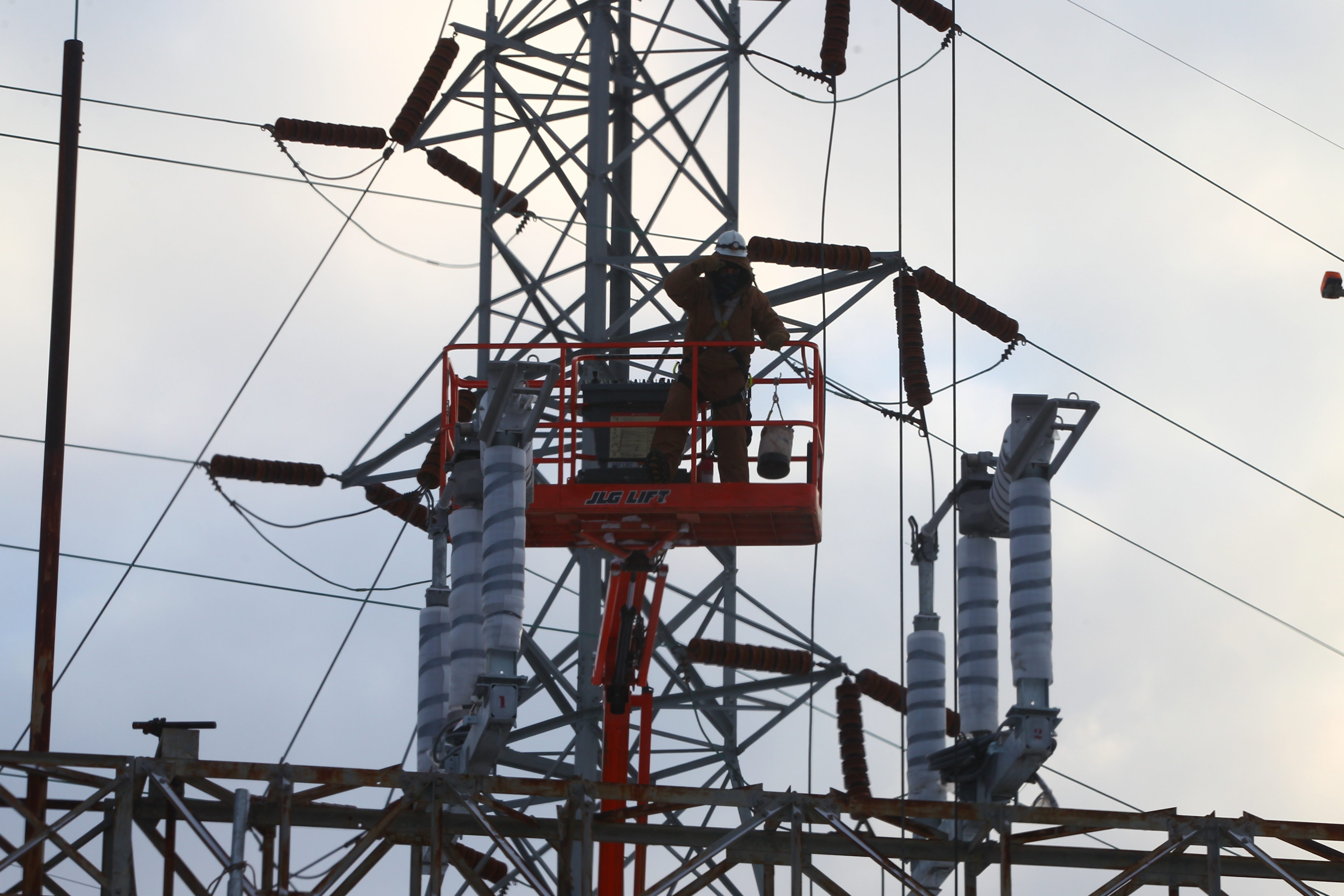 A worker on a high lift directs a crane operator at a National Grid Station in Tonawanda in 7-degree weather on Jan. 21. Sen. Charles Schumer has called for a Federal Trade Commission investigation of a spike in electric bills.