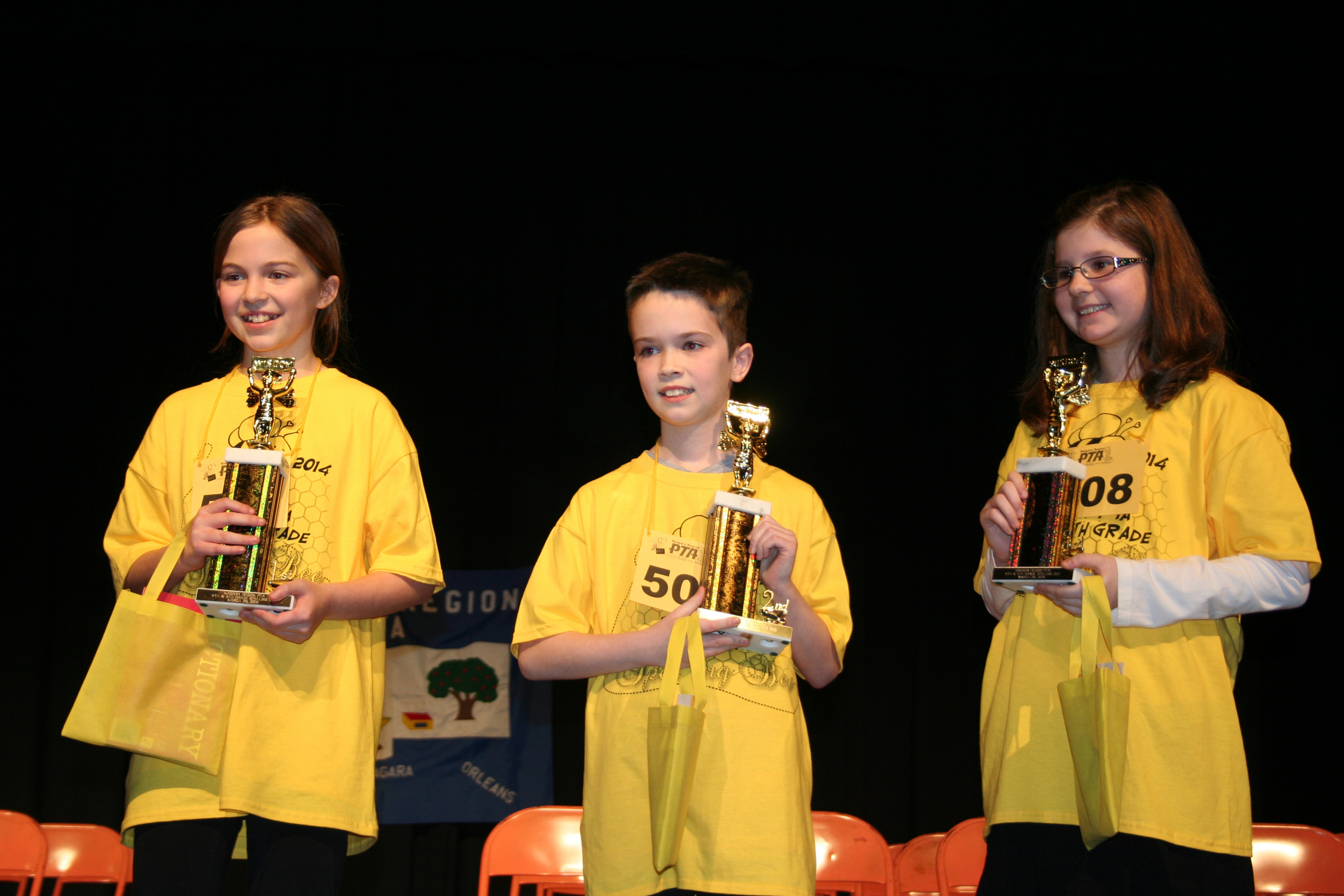 Hannah Schiffmacher, left, finished first, followed by Caden Kerr and Christine Wood in last week's Niagara Region PTA spelling bee.