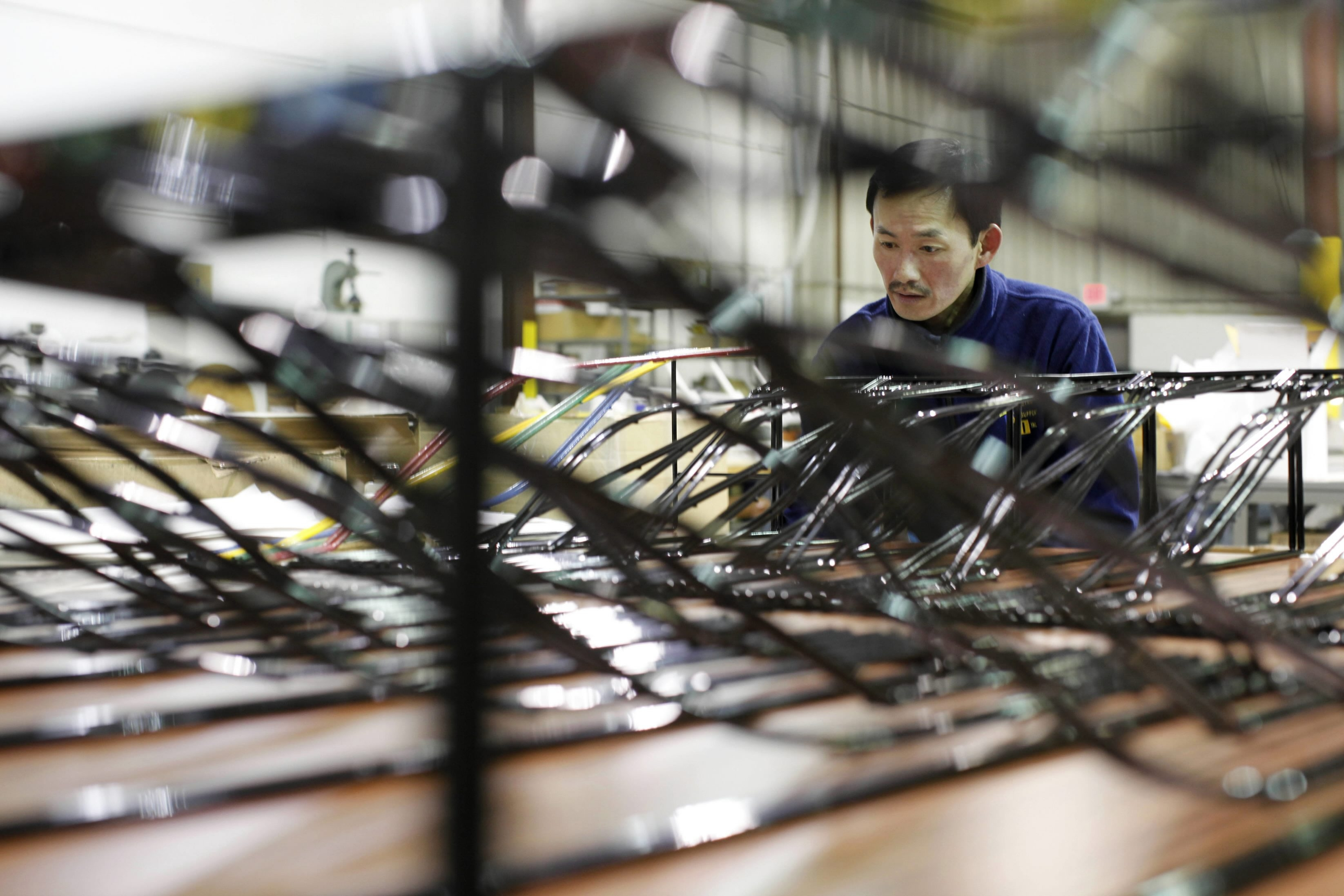 Young Nguyen assembles products at ISI, whose president hopes that state budget incentives will boost firm's competitiveness.
