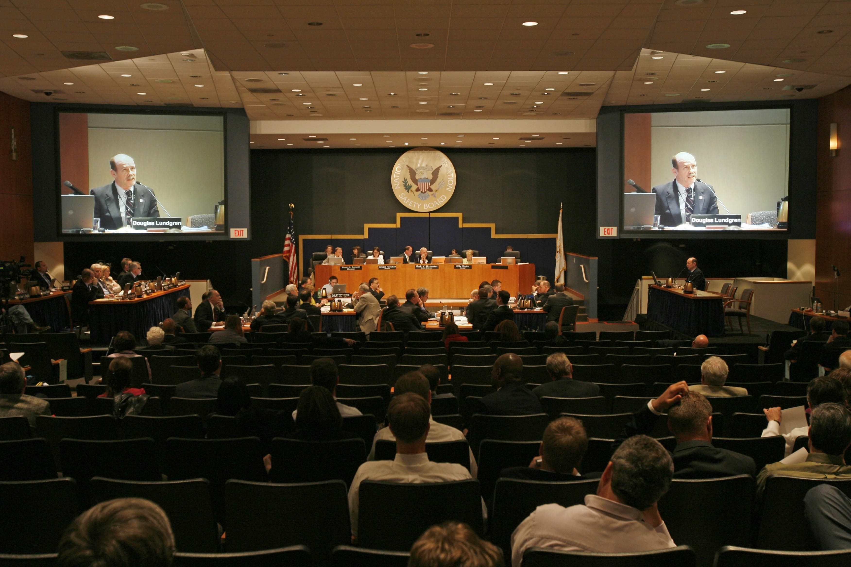 Douglas Lundgren of Colgan Air is projected on television screens as he testifies at the NTSB hearing about the Flight 3407 crash in the NTSB Conference Room in Washington, DC on May 13, 2008. (Derek Gee/Buffalo News file photo)