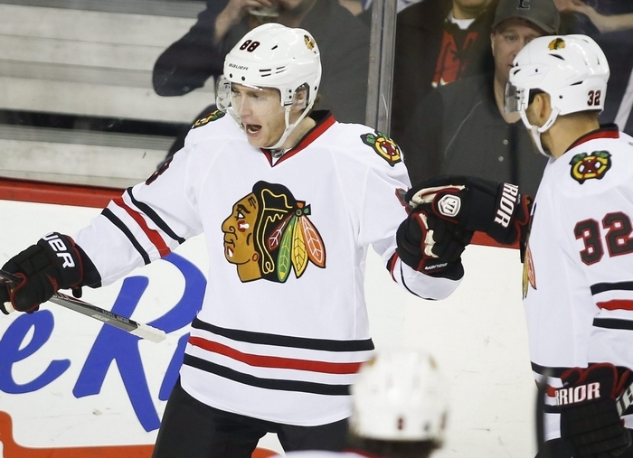 The Olympic tournament will cause wear and tear on Patrick Kane, left, and his NHL counterparts who are competing in Sochi, Russia. (Associated Press)