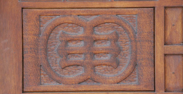 Detail of a carving on the wooden doors at the entrance to the Merriweather Library, Wednesday, April 16, 2014.  (Derek Gee/Buffalo News)