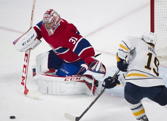 Montreal Canadiens goalie Carey Price makes a save against Cody Hodgson of the Sabres in the first period of Tuesday night's game in the Bell Centre. (Associated Press)