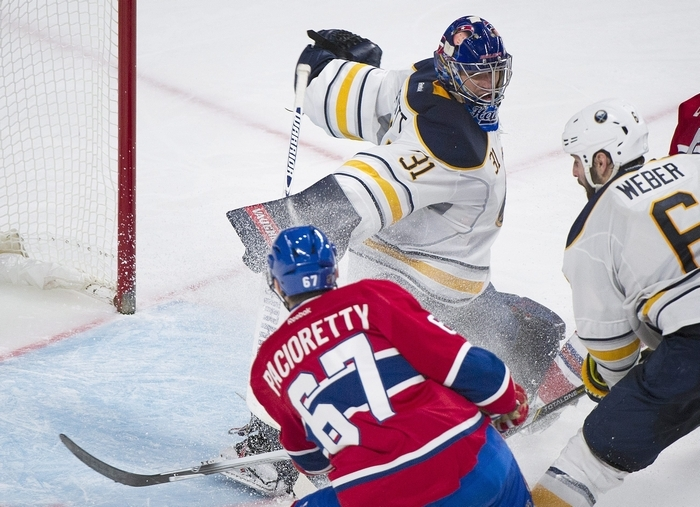 Montreal's Max Pacioretty scores the first goal of the game in the third period against Sabres goaltender Matt Hackett Tuesday. (Associated Press)