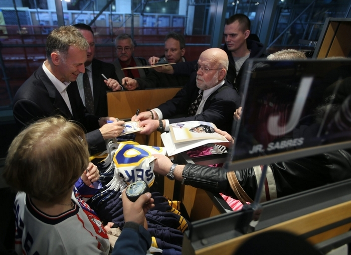 Sabres goaltender Dominik Hasek signs autographs for fans at the Sabres Store in the First Niagara Center. Hasek is set to be inducted into the Sabres Hall of Fame on Saturday. (Charles Lewis/Buffalo News)