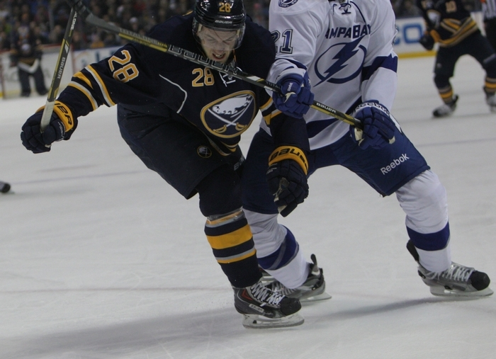 The Sabres' Zemgus Girgensons fights for the puck with Tampa Bay's Michael Kostka as Girgensons returned to the lineup after missing 11 games. (Sharon Cantillon/Buffalo News)
