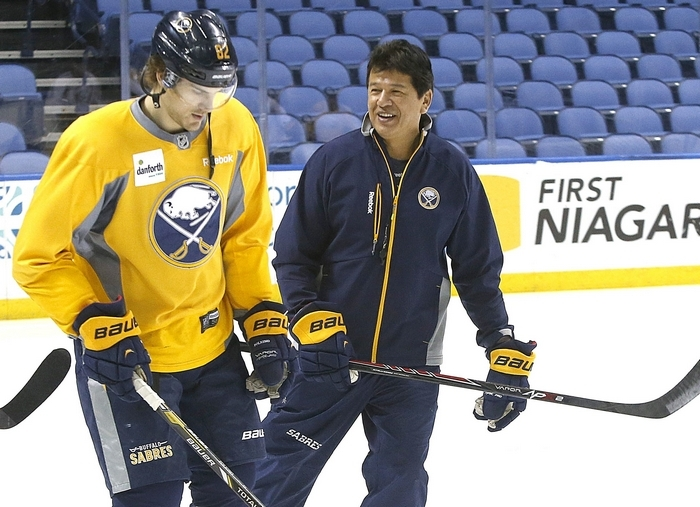 Sabres head coach Ted Nolan speaks with Marcus Foligno at practice this morning at First Niagara Center after the coach signed the contract extension. (Robert Kirkham/Buffalo News)