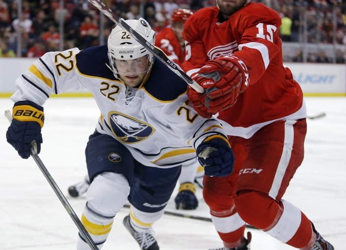 Johan Larsson of the Sabres races Detroit's Riley Sheahan to the puck against the boards during the second period. (Associated Press)