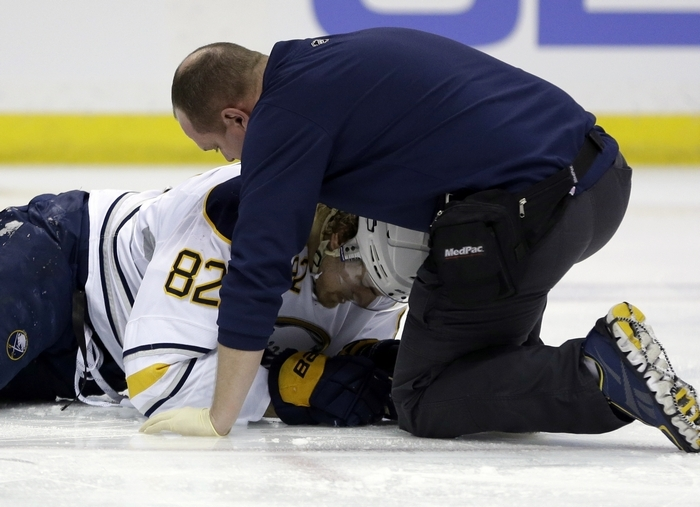 The Sabres' Marcus Foligno is tended by a trainer after being injured during the first period against the St. Louis Blues. He left the game. (Associated Press)