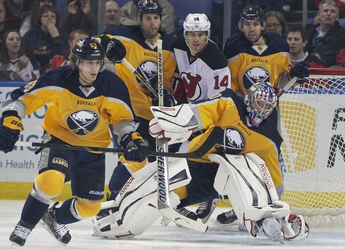 Sabres goalie Nathan Lieuwen (50) makes a save against New Jersey's Marek Zidlicky (2) in the first period of Tuesday night's game. (James P. McCoy/ Buffalo News)