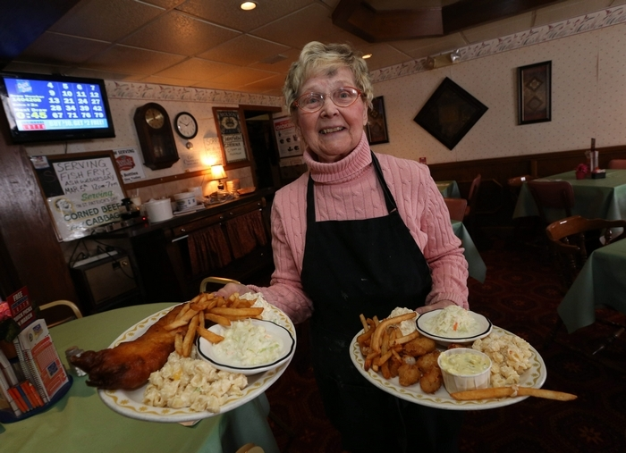 Just as she has for more than 60 years, Terry Kiebzak delivers fried fish dinners to tables at Kiebzak's Restaurant in Sloan on Wednesday, March 5, 2014. (Robert Kirkham/Buffalo News)