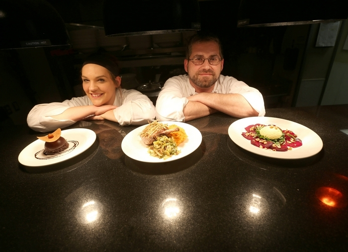 Sous chef Shannon McNerney, left, and executive chef Eric Kloss, right, are shown in the kitchen at the 31 Club. (Photos by Robert Kirkham/Buffalo News)