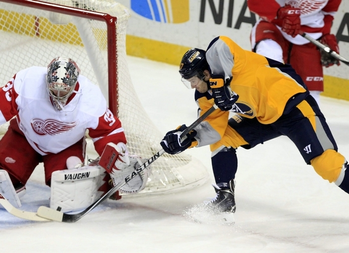 Torrey Mitchell (17) if the Sabres is stopped by  Red Wings goalie Jimmy Howard (35) in the first period Tuesday night. (Harry Scull Jr. /Buffalo News)