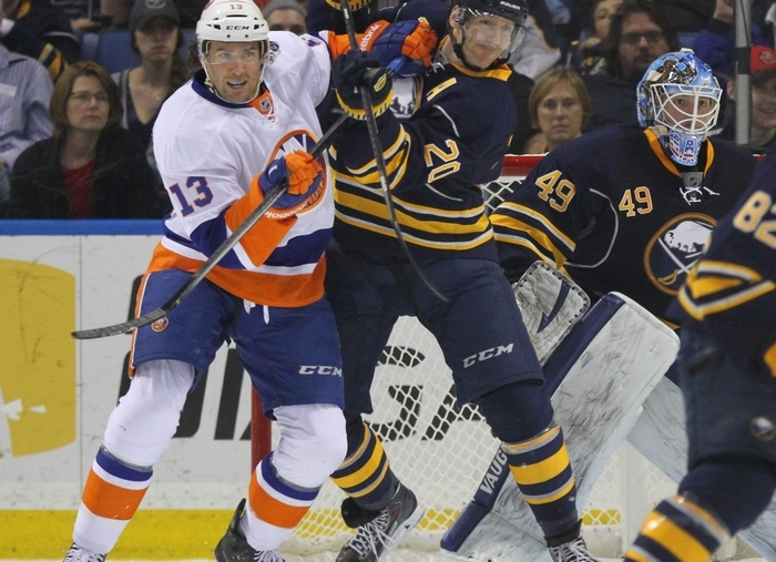 The Sabres' Henrik Tallinder battles with the Islanders' Colin McDonald during the first period of Sunday's season finale at First Niagara Center. (Mark Mulville/Buffalo News)