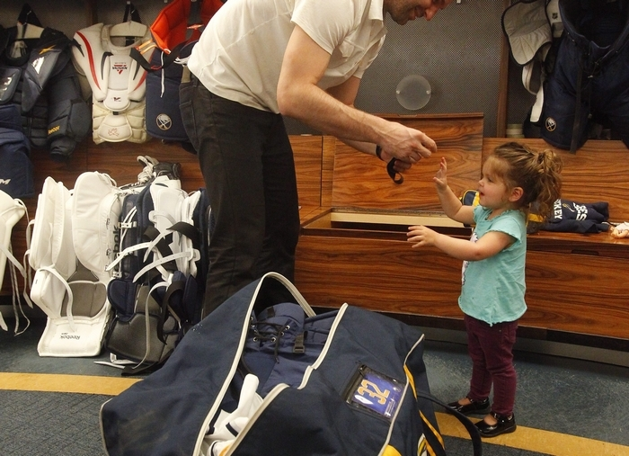 Sabres forward John Scott gets some help from his daughter Ava, 2, at the locker cleanout  at First Niagara Center on Monday. (John Hickey/Buffalo News)