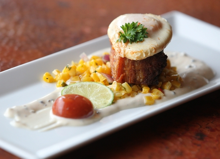 """The appetizer Bacon & Egg at Brioso by Butterwood on Main Street in Williamsville includes pork belly chicharrones, charred corn salsa, ranchero poached egg, """"bloody mary"""" pearls and maple-black pepper crema. (Sharon Cantillon/Buffalo News)"""