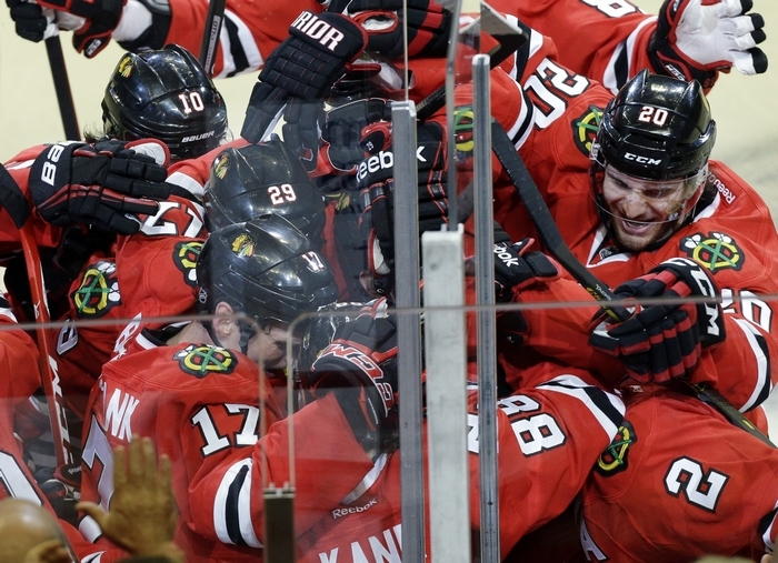 The Blackhawks' Patrick Kane (88) celebrates with teammates after scoring the game-winning goal during overtime in Game Four to tie the first-round playoff series against the St. Louis Blues. (Associated Press)