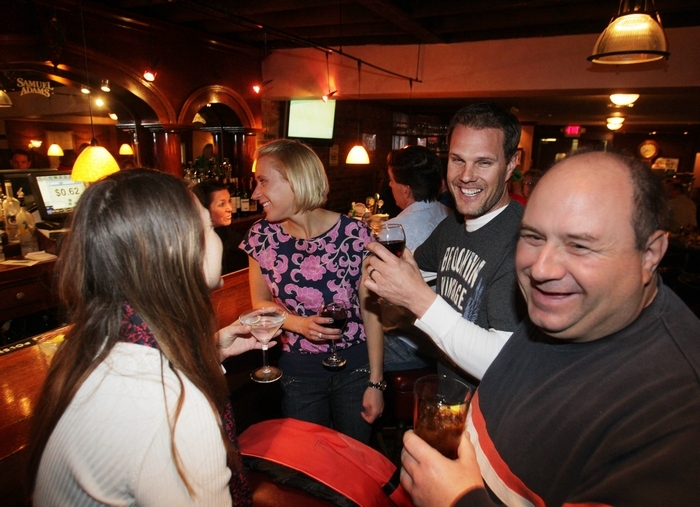 Christine Kurek, Nicolle and Chris Overkamp and Chris Petrie socialize at the bar in the Glen Park Tavern on Main Street in Williamsville. (Sharon Cantillon/Buffalo News)
