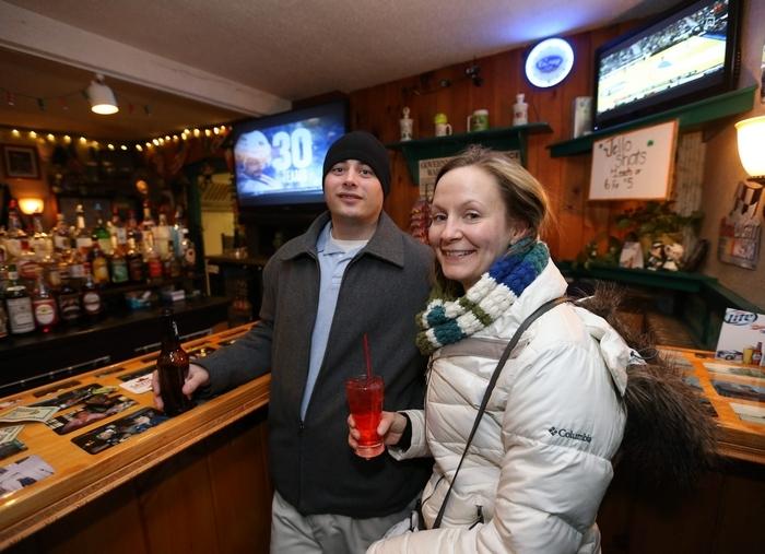 Chad Brill of Buffalo and Donna Bridges of Hamburg enjoy a drink at Cook's Bar on Katherine Street. (Photos by Robert Kirkham/Buffalo News)