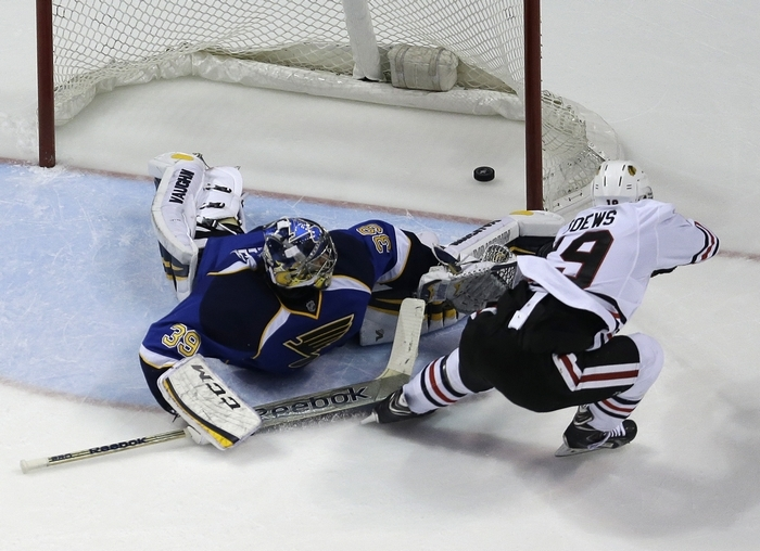 Chicago Blackhawks' Jonathan Toews scores the game-winning goal past St. Louis Blues goalie Ryan Miller in overtime. (Asssociated Press)