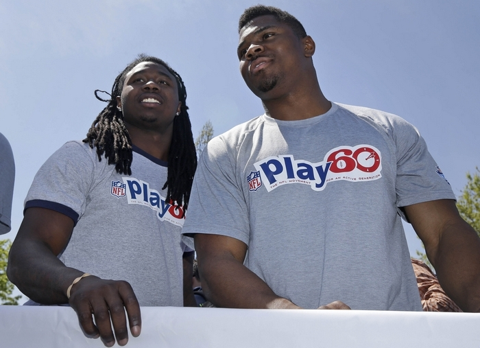 Clemson's Sammy Watkins, left, and UB's Khalil Mack participate in the NFL's Play 60 Youth Football Festival where they helped kid through various drills. (Associated Press)