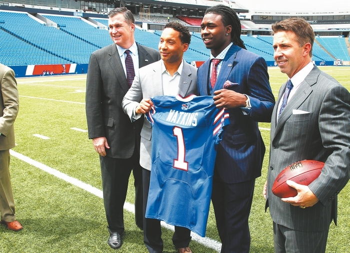 Coach Doug Marrone, GM Doug Whaley and president Russ Brandon welcome Sammy Watkins, second from right, to the Buffalo Bills. (John Hickey/Buffalo News)