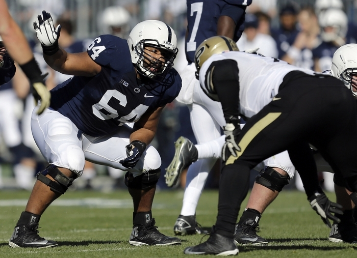 Penn State guard John Urschel (64), the 175th pick overall, will be tried at both guard and center by the Baltimore Ravens. (Associated Press)