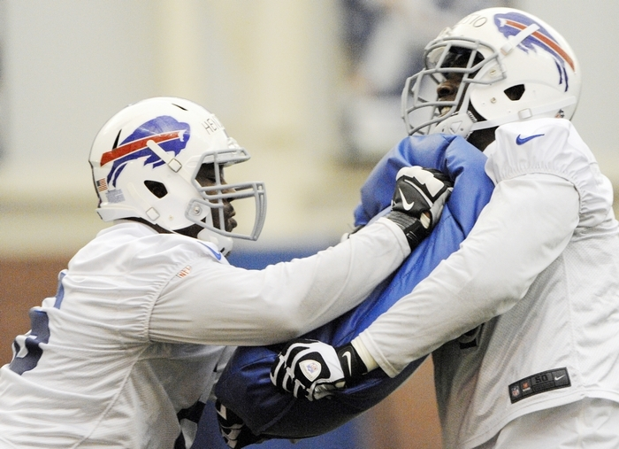 Bills seventh-round draft pick Seantrel Henderson, left, works with fellow draftee Cyrus Kouandjio during a drill Sunday at rookie camp. (Associated Press)