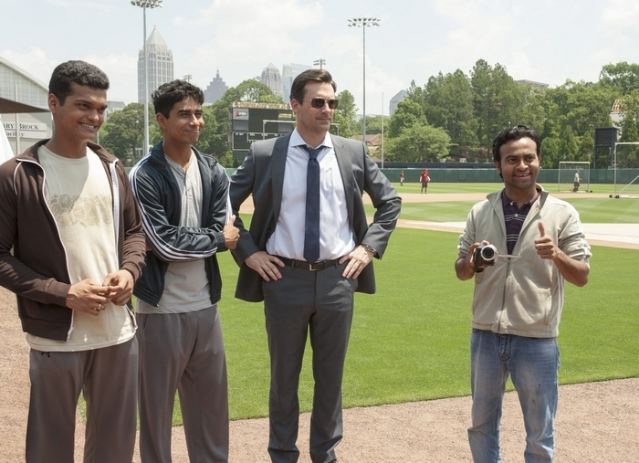 """Sports agent J.B. Bernstein (Jon Hamm, center) brings young hopefuls Dinesh (Madhur Mittal, left) and Rinku (Suraj Sharma) to America for a shot at the major leagues along with translator Amit (Pitobash) in""""Million Dollar Arm."""""""
