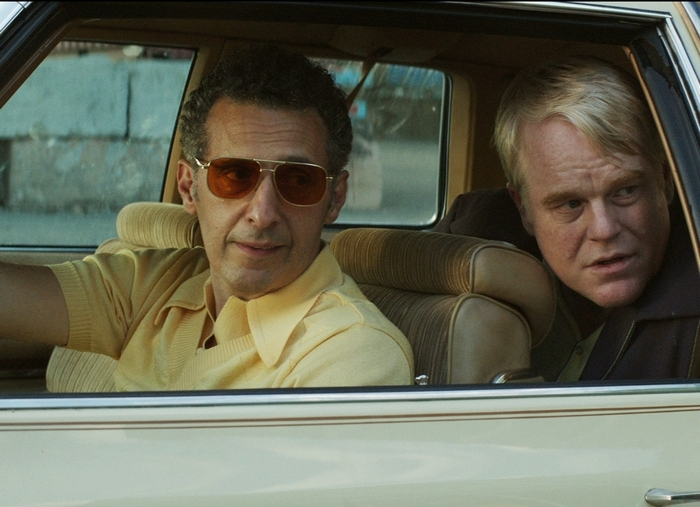 "John Turturro, left, and Philip Seymour Hoffman are seedy buddies in search of  happiness in ""God's Pocket."""