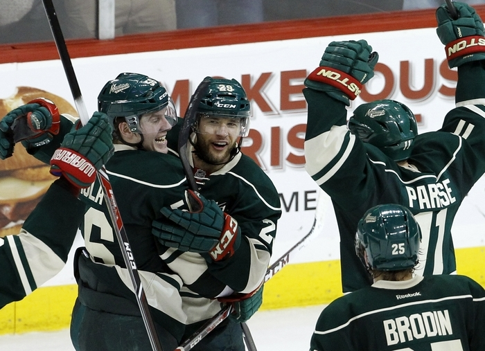 Winger Jason Pominville, center, is among the former Sabres moving into the second round of the playoffs with the Minnesota Wild. (Associated Press)