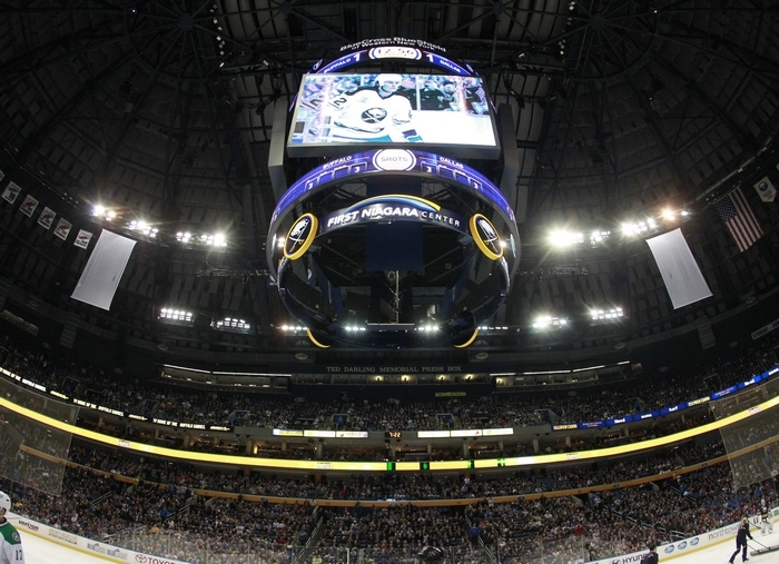 Buffalo Sabres fans watch a tribute to Dallas Stars coach Lindy Ruff, during first period action at the First Niagara Center,on Monday, Oct. 28, 2013. The team today announced a hike in season ticket prices for next season. (Harry Scull Jr./Buffalo News)
