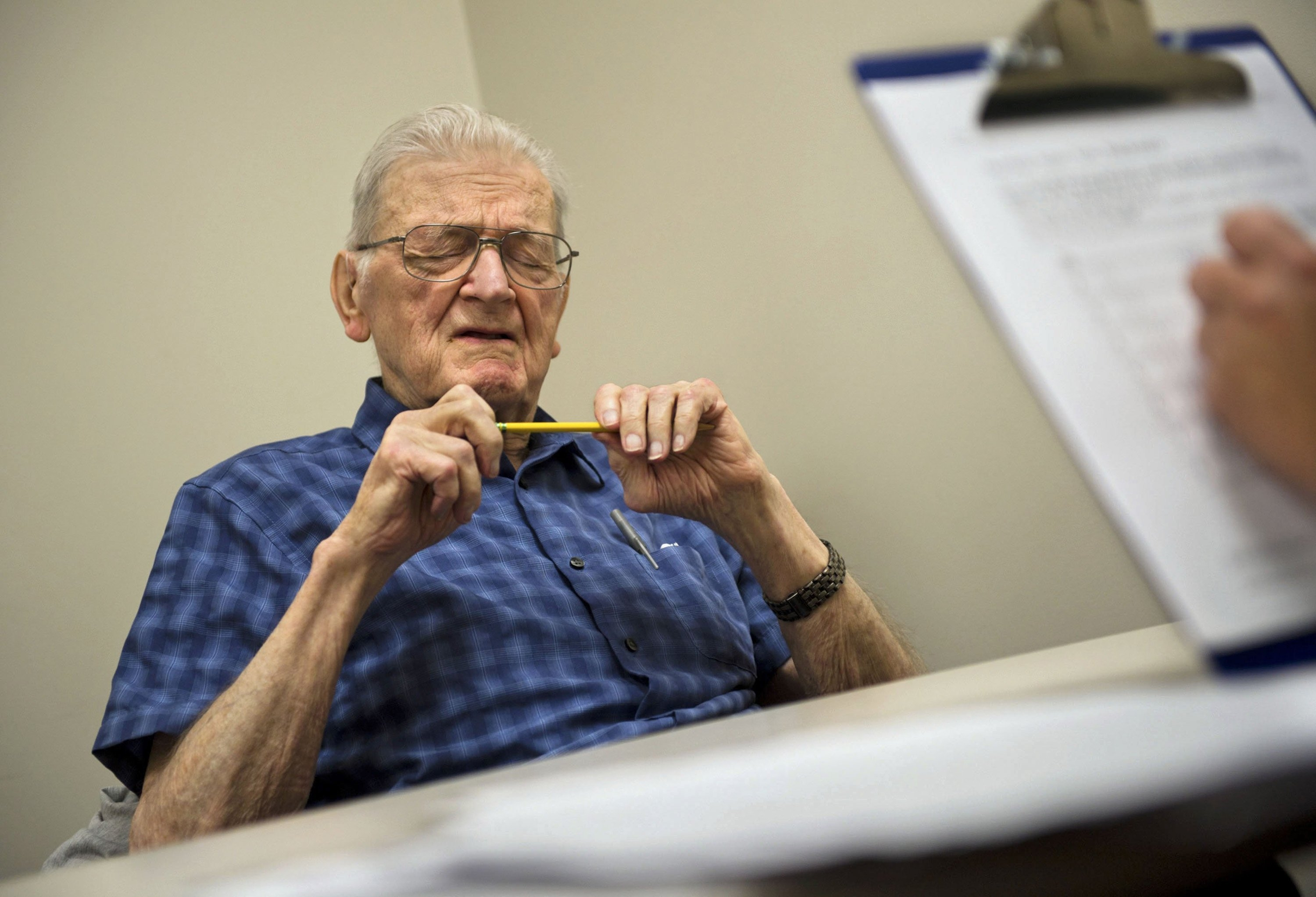 Joseph Giel, 90, closes his eyes to recall something while he takes a mini-mental status exam at the UC Davis Alzheimer's Disease Center in Sacramento, Calif. Past testing has shown Giel to be in good cognitive shape.