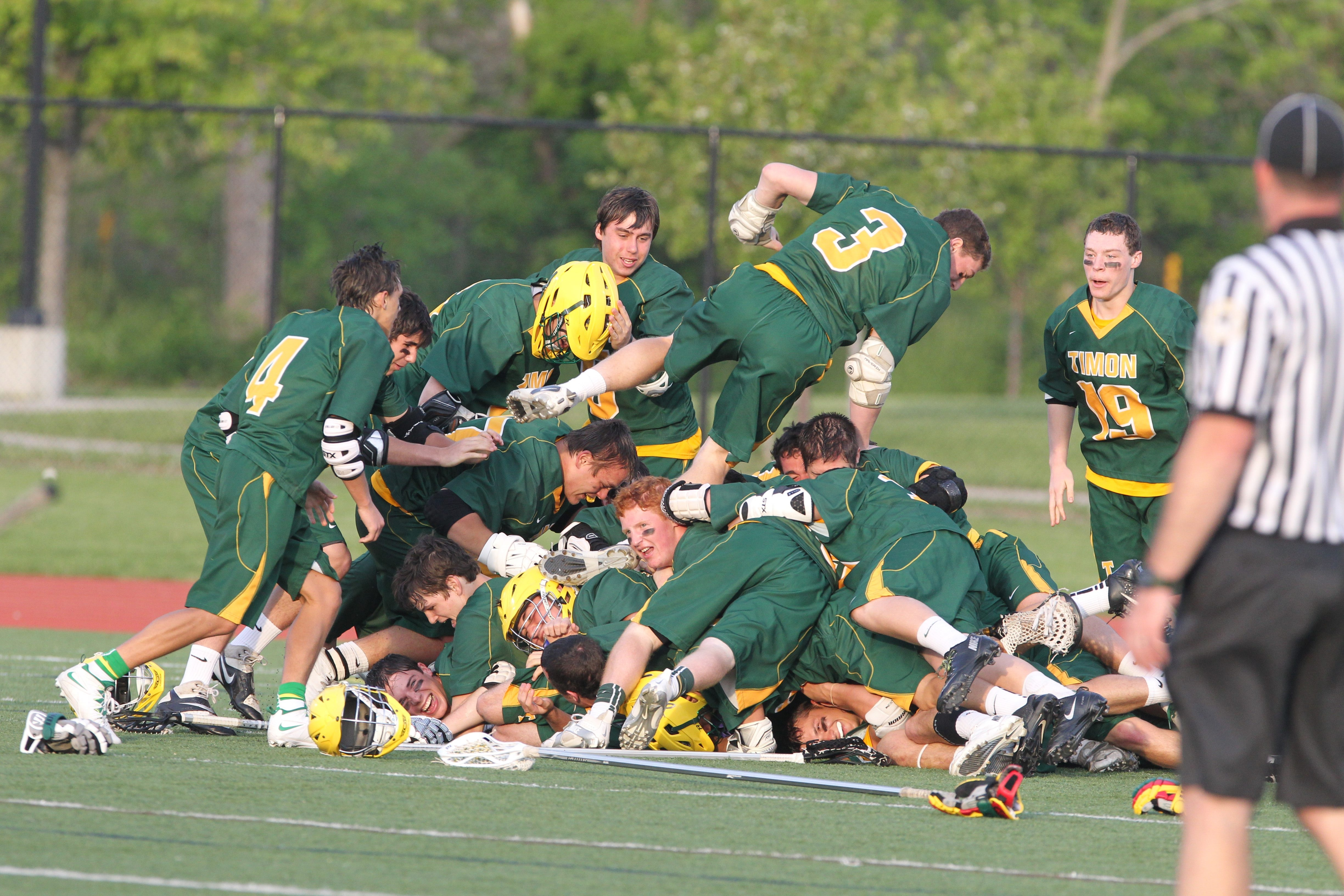 Bishop Timon-St.Jude players pile on each other after Thursday's MMA championship win over St. Joe's at All High Stadium.