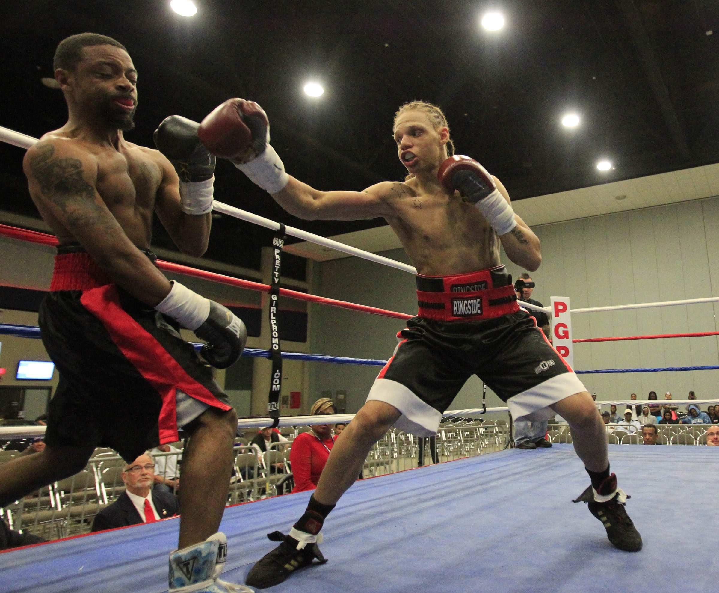 Super featherweight Lavias Williams, right, defeats DeWayne Wisdom in a second round TKO at the Buffalo Niagara Convention Center Thursday.